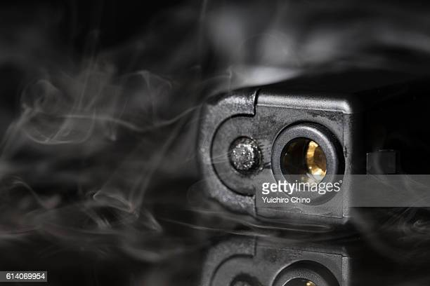 smoking gun - gun control stock pictures, royalty-free photos & images