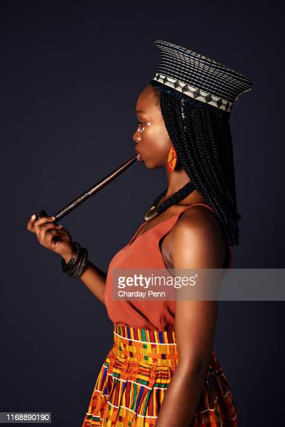 smoking has different symbolism in different cultures - zulu women stock pictures, royalty-free photos & images