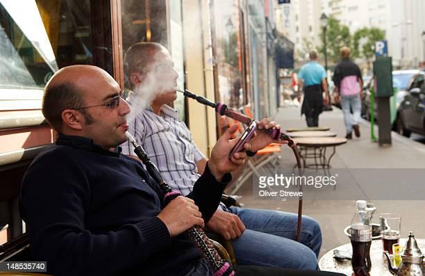 Smoking hookah pipes.