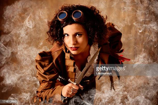 smoking hot steampunk pirate queen with knife and goggles - pirates headshots stock pictures, royalty-free photos & images