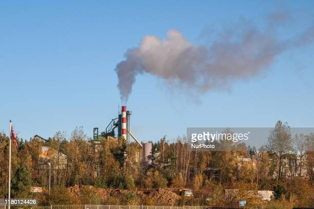 Smoking huge chimney of the coal powered heating plant used to supply heat to apartments in the southern parts of the city is seen in Gdansk, Poland...