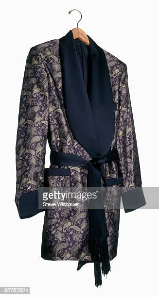 smoking jacket on wooden hanger - smoking jacket stock photos and pictures