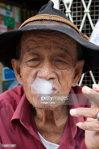 smoking man. - jakarta stock pictures, royalty-free photos & images
