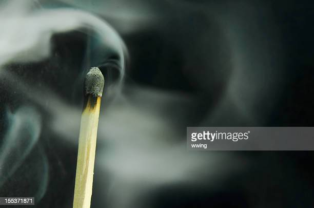 smoking match  ... copy space - burnout stock photos and pictures