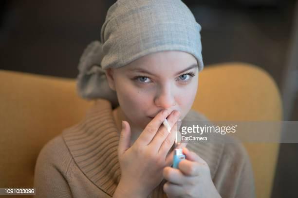 smoking medical marijuana - medical cannabis stock pictures, royalty-free photos & images