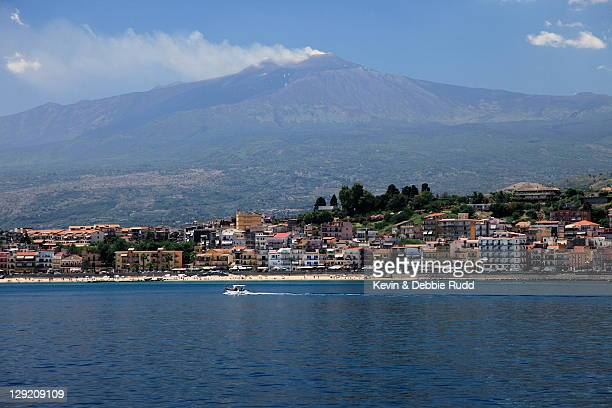 smoking mt etna - giardini naxos stock pictures, royalty-free photos & images