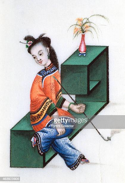 Smoking opium mid 19th century A Chinese woman smoking a pipe of opium an addictive narcotic drug produced from the sap of the opium poppy Her feet...