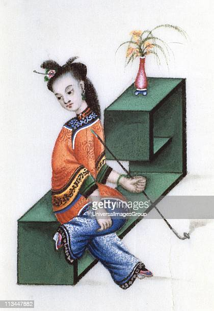 Smoking opium mid 19th century Chinese lady smoking a pipe of opium an addictive narcotic drug produced from the sap of the opium poppy Her feet...