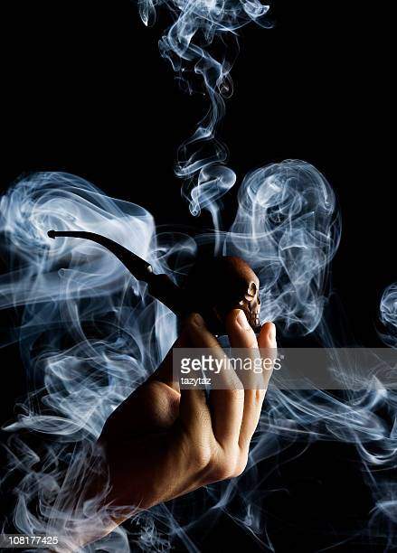 smoking pipe - sherlock holmes stock pictures, royalty-free photos & images