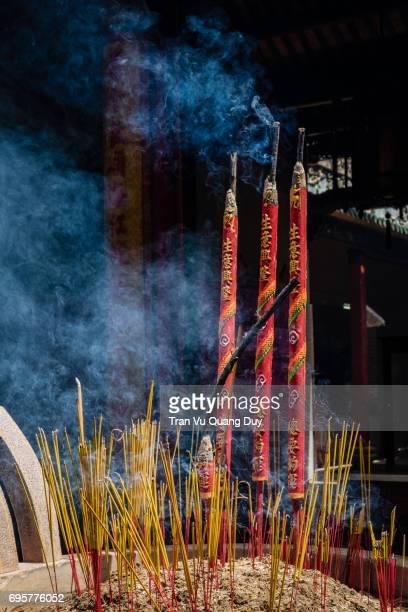 smoking prayer sticks in copper urns. thien hau pagoda, ho chi minh, vietnam. - thien hau pagoda stock pictures, royalty-free photos & images