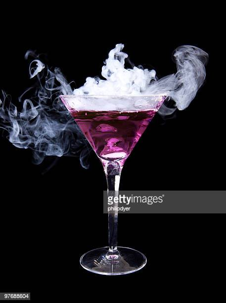 smoking purple martini - dry ice stock pictures, royalty-free photos & images