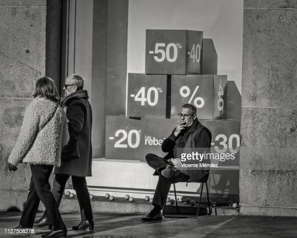 Smoking sitting in a chair on the street