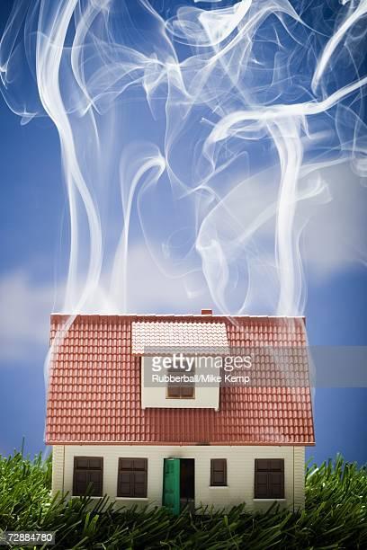 Smoking toy house