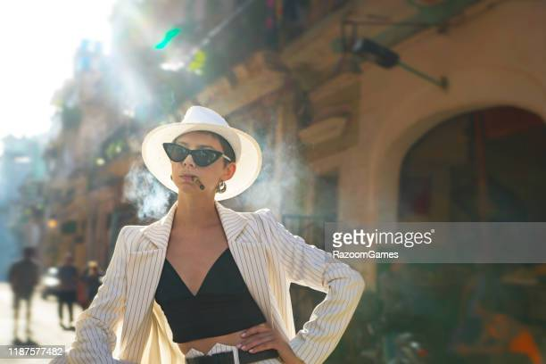 stylish woman white suit white hat