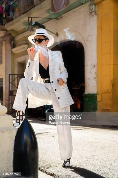 stylish woman white suit white hat