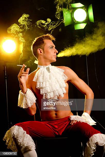 smoking young actor behind the scene - elizabethan collar stock photos and pictures