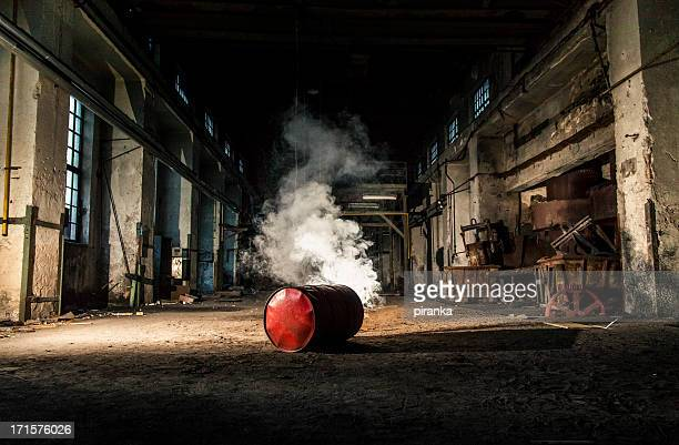 Smoky barrel in an abandoned factory