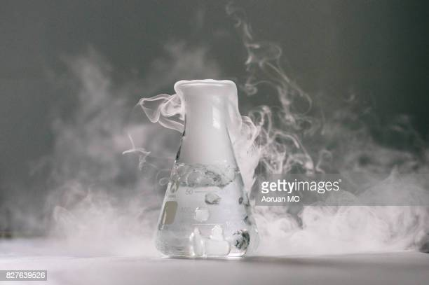 smoky conical bottle - dry ice stock pictures, royalty-free photos & images