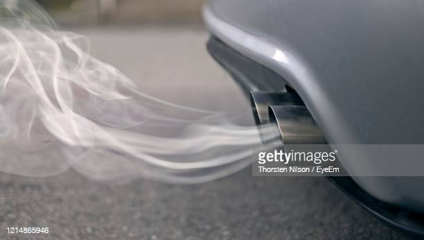smoky exhaust pipes from a starting diesel car. - greenhouse gas stock pictures, royalty-free photos & images