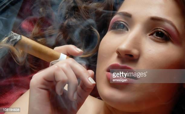 smoky - beautiful women smoking cigars stock photos and pictures