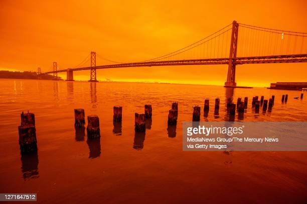 Smoky skies from the northern California wildfires casts a reddish color in San Francisco, Calif., on Wednesday, Sept. 9, 2020.