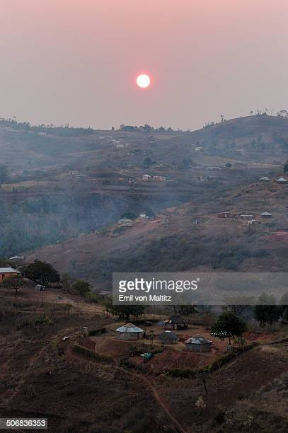 A smoky sunrise over a rural village in a Valley of a Thousand Hills, KwaZulu Natal, South Africa