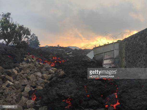 Smoldering ashes are seen early morning in Goma in the East of the Democratic Republic of Congo on May 23, 2021 following the eruption of Mount...