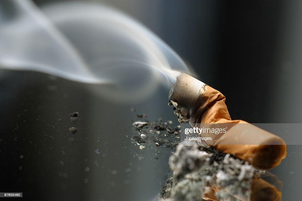 Smoldering cigarette : Stock Photo
