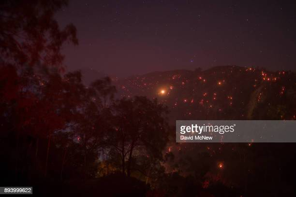 A smoldering mountainside is seen under a starry sky at the Thomas Fire on December 16 2017 in Montecito California The National Weather Service has...