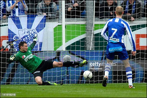 Smolders Tim of KAA Gent scores a penalty by Darren Keet of KV Kortrijk during the Jupiler League match between KAA Gent and KV Kortrijk on March 18...