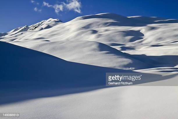 Smooth blanket of snow over hills