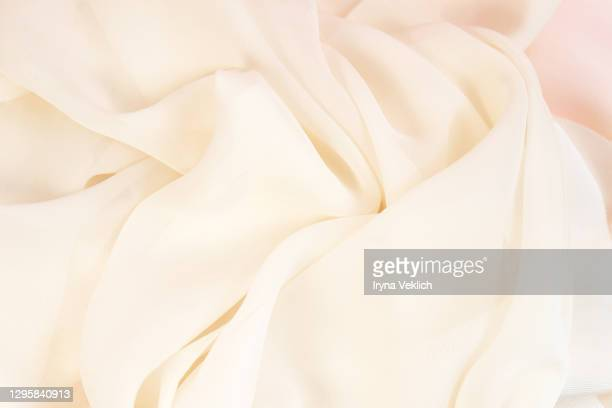 smooth elegant golden silk or satin luxury cloth texture background. - silk stock pictures, royalty-free photos & images