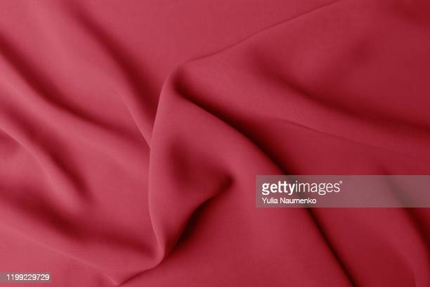 smooth elegant red silk or satin luxury cloth texture can use as abstract background. luxurious valentines day background design. - crease cricket field stock pictures, royalty-free photos & images