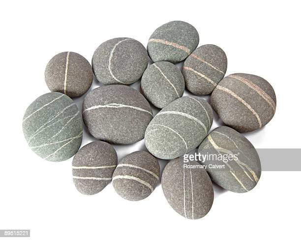 smooth granite pebbles with quartz veins. - pebble stock pictures, royalty-free photos & images