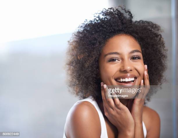 smooth skin puts a smile on her face - black women stock photos and pictures