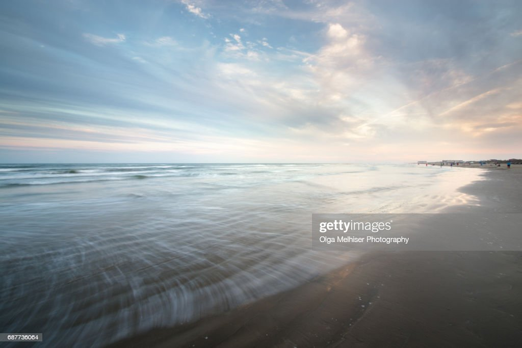 Smooth water at the beach in Port Aransas at sunset, Texas, USA : Stock Photo