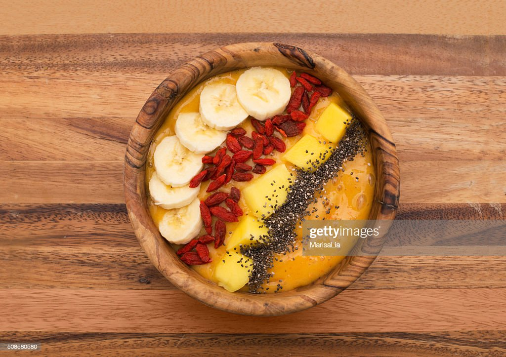 smoothie bowl topped with goji, banana, mango and chia seeds : Stock Photo