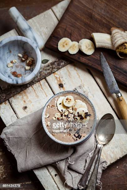 Smoothie bowl with bananas, roasted hazelnuts and other ingredients