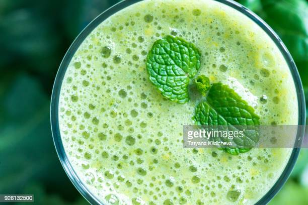 Smoothie made from green vegetables styled with fresh mint leaves