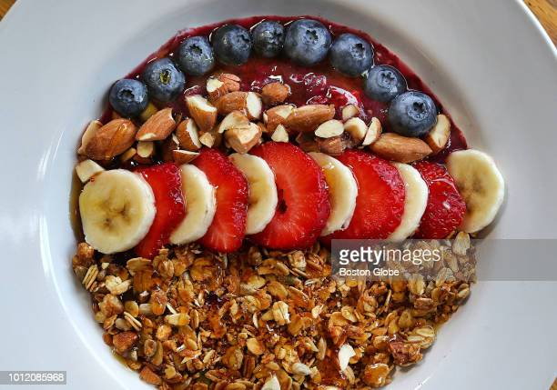 A smoothiebased roasted granola dish with roasted almonds and fruit is pictured at The Roasted Granola Cafe on Massachusetts Avenue in Arlington MA...