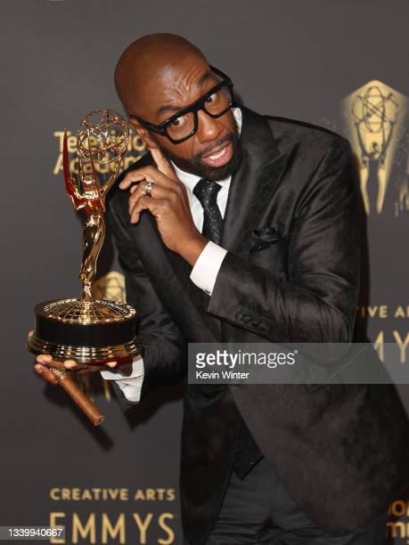 """Smoove poses with the award for Outstanding Actor in a Short Form Comedy or Drama Series for """"Mapleworth Murders"""" at the Creative Arts Emmys at..."""