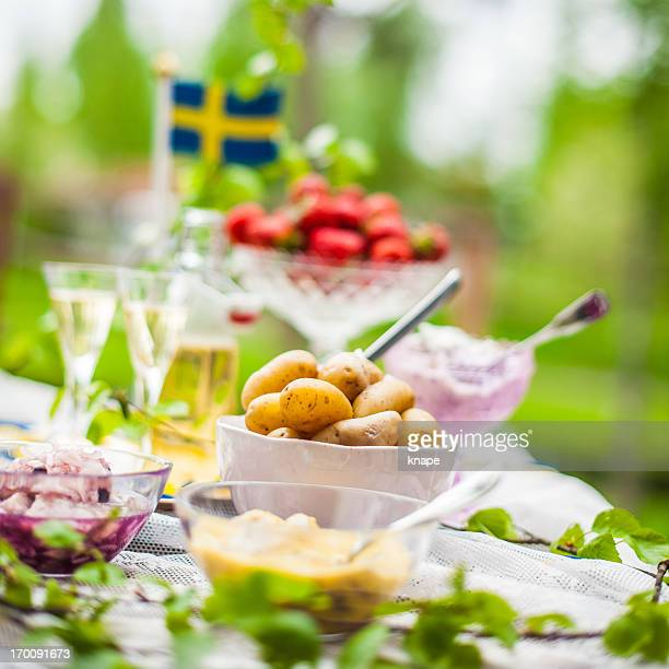 Smörgåsbord with pickled herring and snaps