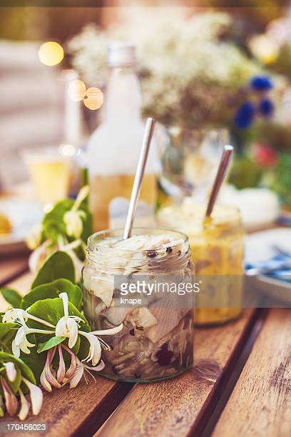 smörgåsbord with pickled herring - pickled stock photos and pictures