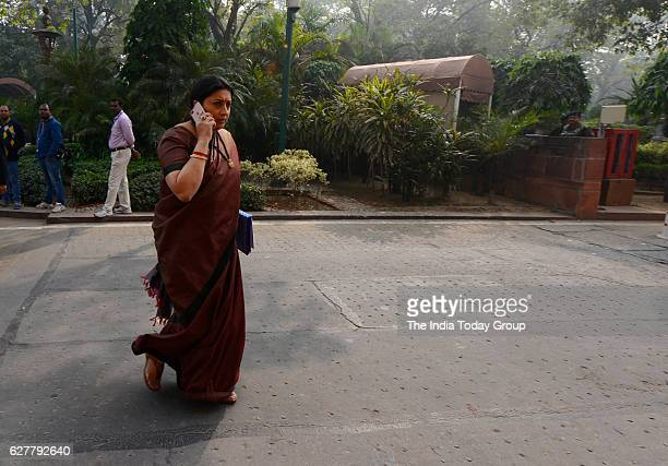 Smriti Irani arrives at Parliament House during the ongoing parliamentary winter session in New Delhi