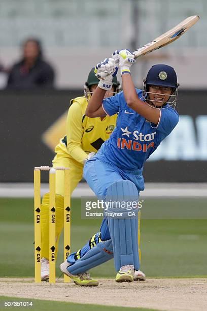 Smriti Mandhana of India bats during the women's Twenty20 International match between Australia and India at Melbourne Cricket Ground on January 29...