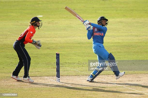 Smriti Mandhana of India bats with Amy Jones wicket keeper of England looking on during the warm up match between England and India ahead of the ICC...