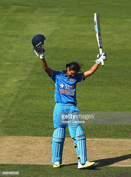 Smriti Mandhana of India celebrates after reaching her century during game two of the women's one day international series between Australia and...