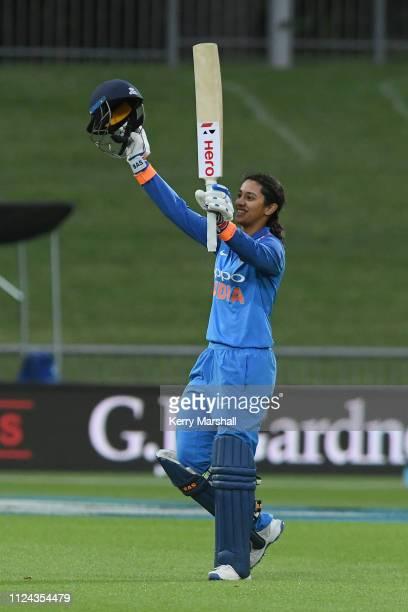 Smriti Mandhana of India celebrates scoring 100 runs during game one of the One Day International Series between New Zealand White Ferns and India at...