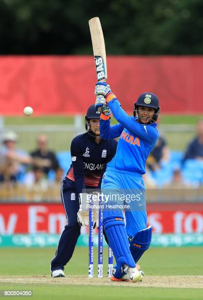 Smriti Mandhana of India drives the ball straight to Danielle Hazell and is caught out during the England v India group stage match at the ICC...