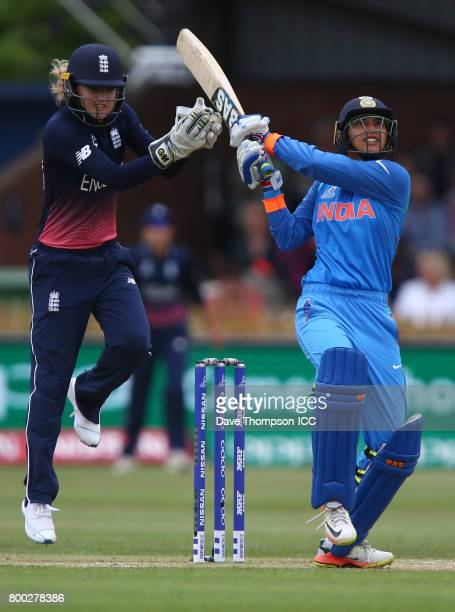 Smriti Mandhana of India plays a shot in front of Sarah Taylor of England during the ICC Women's World Cup match between England and India at The...